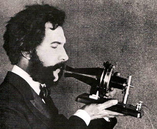 1876_Bell_Speaking_into_Telephone